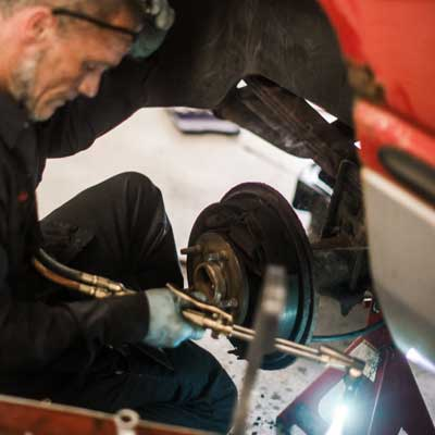 man using torch on brakes