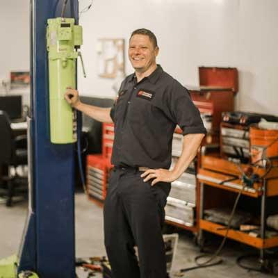 man working car lift